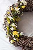 Spring wreath with daffodils, tulips, hyacinth, goldenrod, and sea lavender