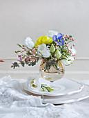 Spring posy of lisianthus, violas, waxflowers and eucalyptus