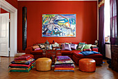 Red living room with many cushions