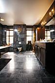Elegant bathroom with dark marble tiles