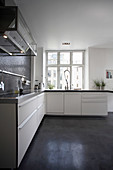 L-shaped kitchen with white cupboards