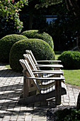 Zen garden with lounge chairs and boxwood balls