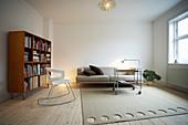 Designer rocking chair, serving trolley, sofa and shelves on castors