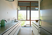 Kitchen with glass wall in loft apartment