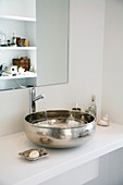 White washstand with silver countertop sink