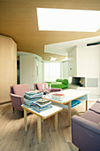 Pink sofa set and tables in open-plan interior