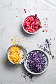 Colourful bath salts with dried flower petals