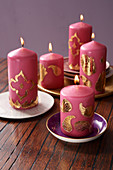 Indian candle arrangement: pink candles decorated with golden wax