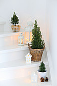 A flight of white stairs decorated for Christmas