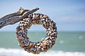 A wreath of shells on the beach