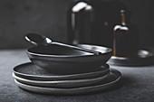 Black plates and bowls