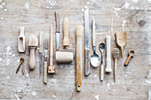 Various kitchen tools with wooden handles on a wooden board