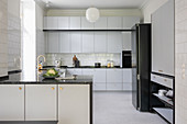 Bright fitted kitchen with kitchen island