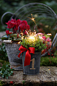 A New Year's flower arrangement with sparkler placed outdoors