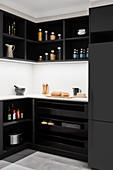 Black kitchen cabinets with white splashback