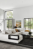 White sofa combination in high-ceilinged open-plan interior