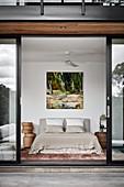 View from terrace through open sliding doors into bedroom