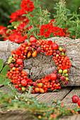 Wreath of berries leaning against tree trunk