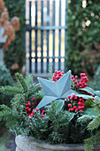 Galvanized Christmas star with sparkling berries and fir branches