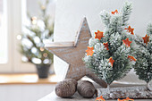 Tiny Christmas tree with stars made of orange peel, wooden star and cones