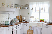 Kitchen corner with wooden worktop and pastel-colored utensils
