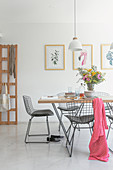 Dining table and classic chairs in a bright room
