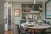 Round dining table and upholstered armchairs