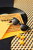 Sunglasses, wedding invitation and vinyl record