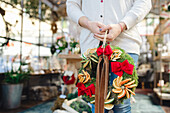 Woman with Christmas wreath in shop