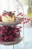 Autumn arrangement of heather, pumpkin face and rose hips