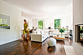 Woman walking through modern living area, Hamburg, Germany