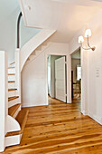 Entrance hall with stairs, House furnished in country style, Hamburg, Germany