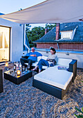 people on a roof terrace of a modern sigle-family house in Hamburg, north Germany, Germany