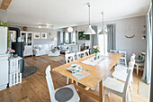 Modern Nordic Living room in family house with white and gray furniture and wooden floor, Korbach, Hesse, Germany, Europe