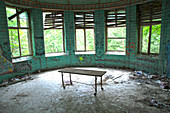 An old operating room with a couch in the abandoned Beelitzer Heilstätten, Beelitz, Germany