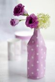 Lisianthus and viburnums in a vase