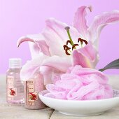 Pink lily, bath puff and bath products