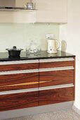 Kitchen with brown wooden drawer fronts