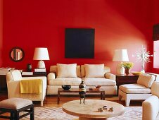 Dark blue artwork on red wall in interior with pale furniture