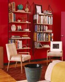 Interior with 70s shelves mounted on bright red walls and 50-style chairs