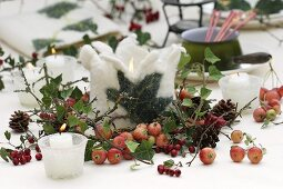 Wintry table decoration with candles and felt