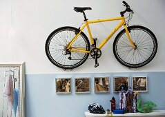 Bicycle hanging on wall in hall