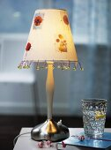 Table lamp decorated with beads and flowers