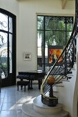 A flight of stairs with a banister rail and a piano