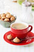 Red espresso cup with amarettini