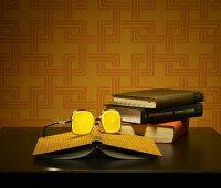 Books and glasses with lemon-slice lenses