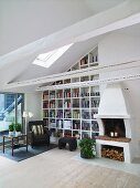 Living room with fireplace and bookshelves