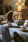 Elegantly laid table in country house