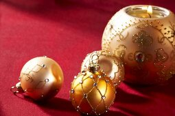 Christmas baubles and a ball shaped candle holder