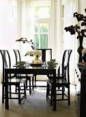 Black dining table, chairs and cabinet